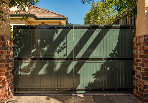 Wooden feature driveway gates with metal decoration
