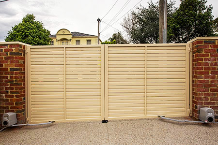 Electric gate motors for automatic driveway gates for Motorized driveway gate price
